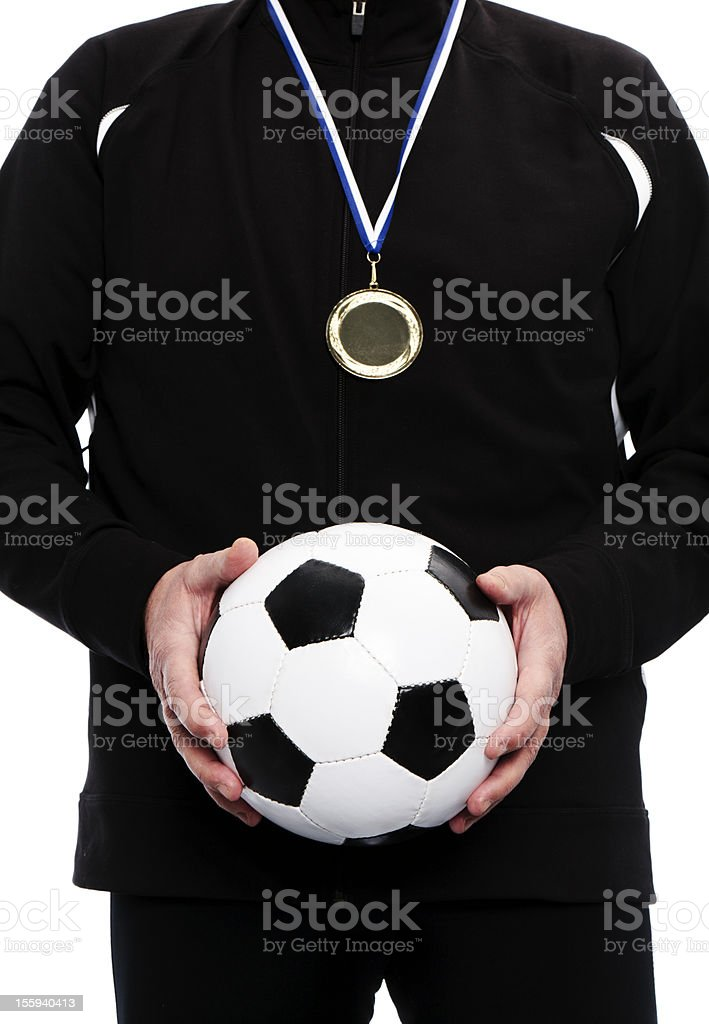 champion holding soccer ball royalty-free stock photo