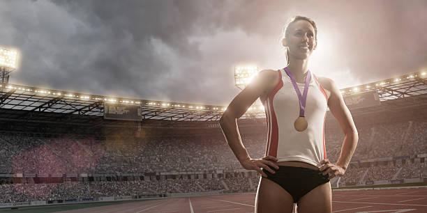 Sportif de compétition gagnant de la médaille d'or - Photo