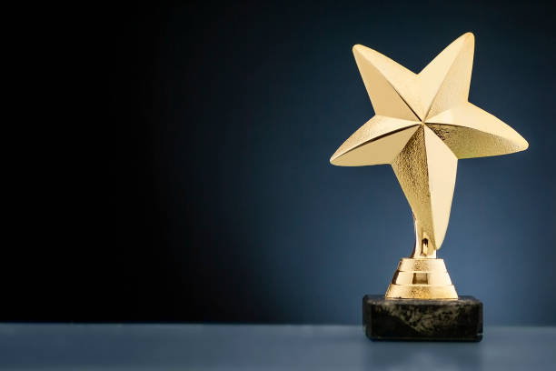 Championship or race trophy with a gold star stock photo