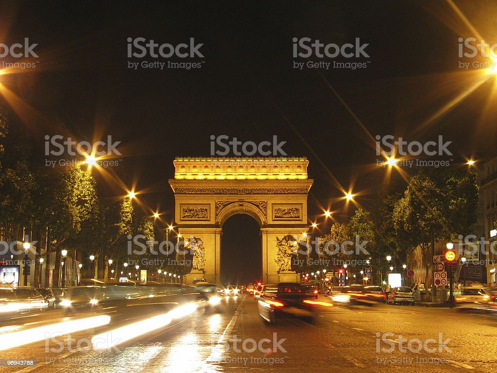 Champs-Elysees and Arc de Triomphe in Paris by night royalty-free stock photo