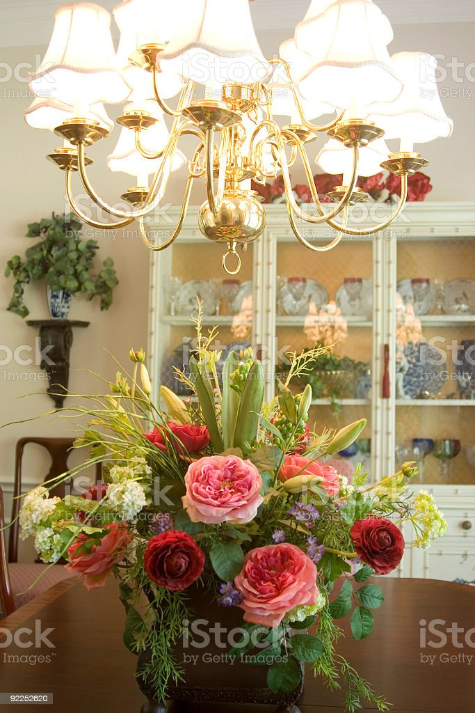 Chandelier and Flower Arrangement royalty-free stock photo