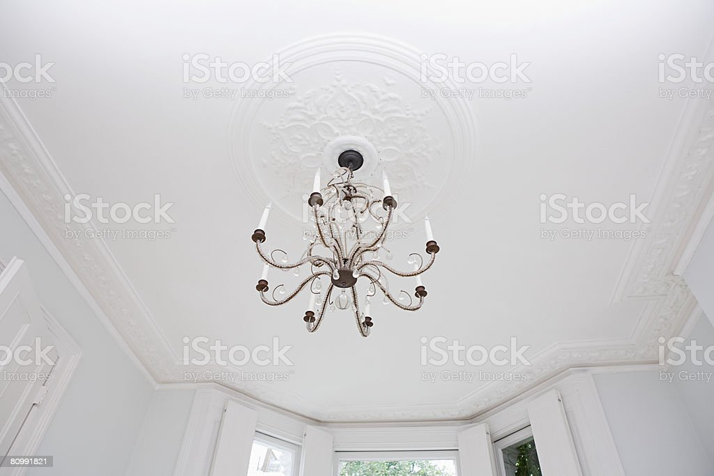 Chandelier hanging from a ceiling 免版稅 stock photo
