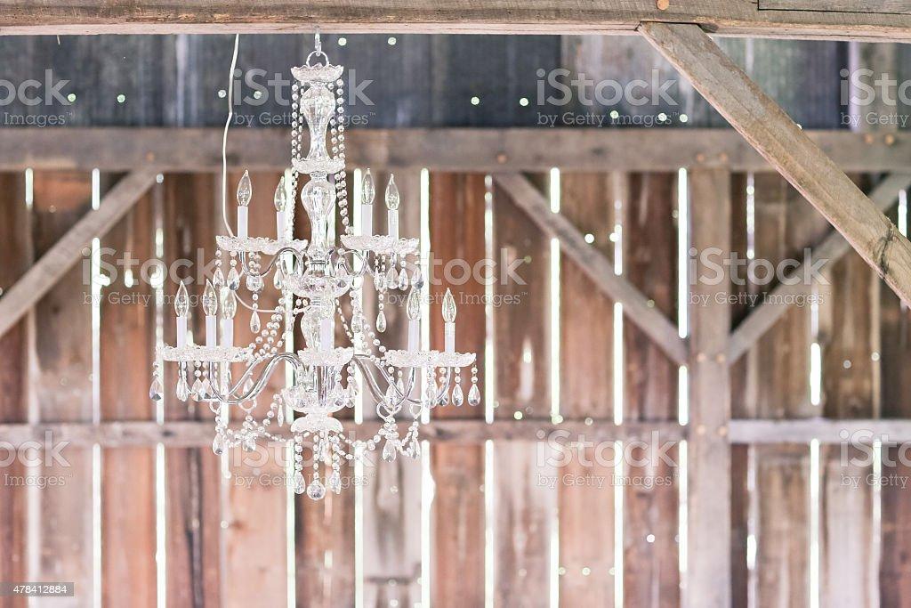 Chandelier hanging in barn stock photo