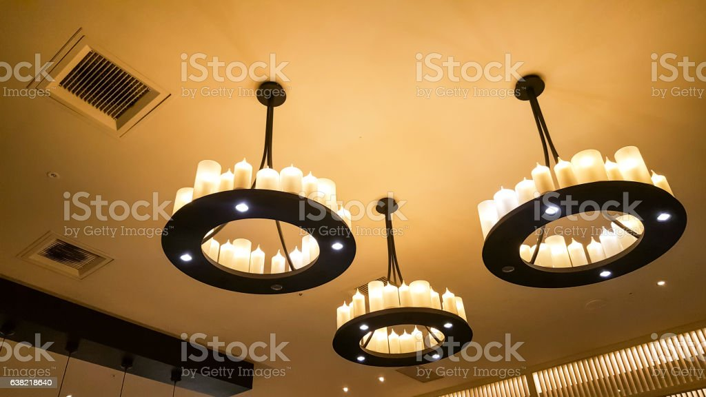 Chandelier hanging under a ceiling stock photo