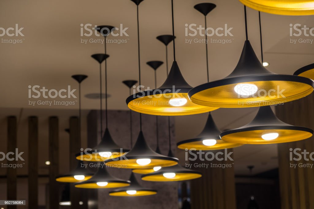 Chandelier lights hanging from the ceiling stock photo