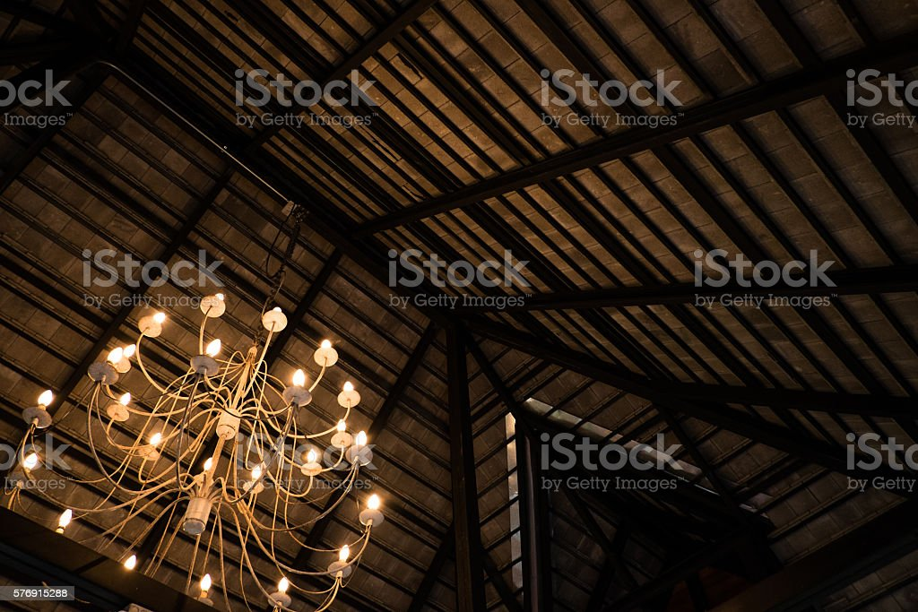 Chandelier on wood roof background. stock photo