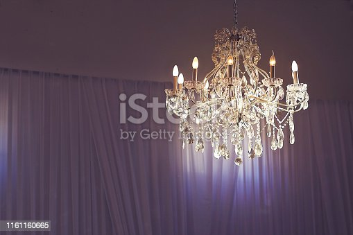 Wedding chandelier with white draping at night South Africa