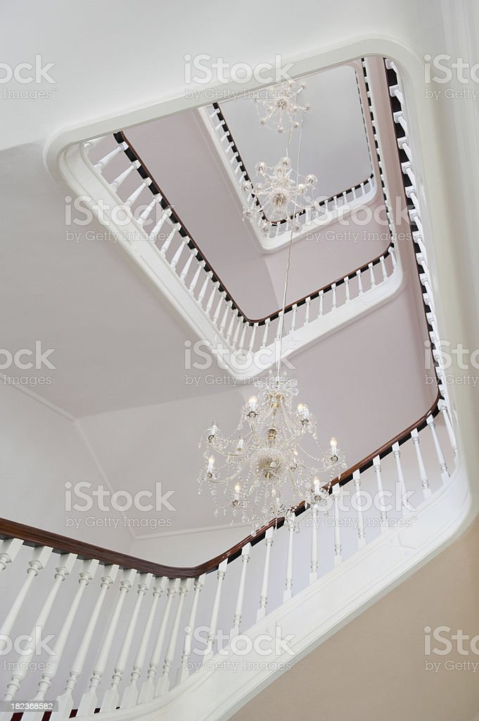Chandeliers in between of a spiral stairwell royalty-free stock photo