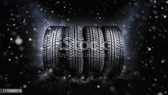 change a car tires from summer for winter - isolated