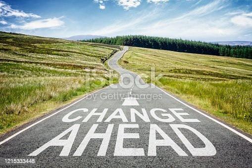 Change ahead sign on the highway disappearing into the distance concept for business planning, strategy and challenge or career path, opportunity and changes