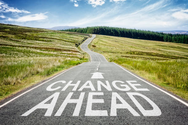 Change ahead sign on the road disappearing into the distance stock photo