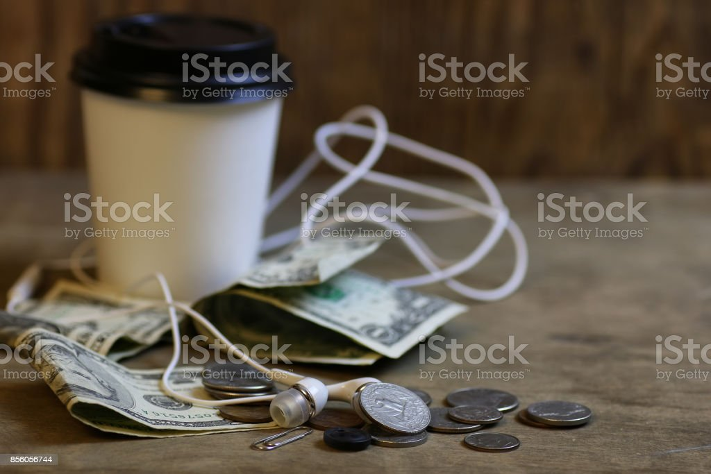 change and crumpled banknote stock photo