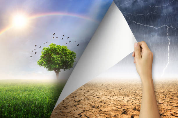 Change concept, Open paper. Change concept, Woman hand turning arid and rain with lightning storm environment paper page to good environment. alteration stock pictures, royalty-free photos & images