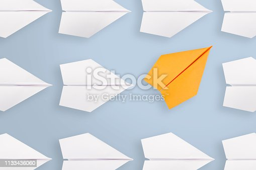 istock Change concepts with orange paper airplane leading among white 1133436060