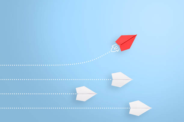 Change concepts with red paper airplane leading among white stock photo