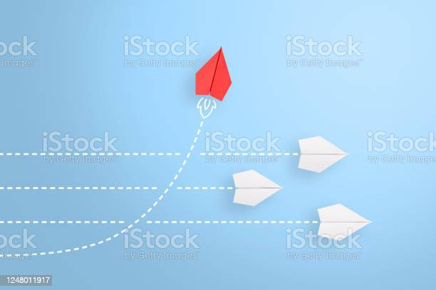 Photo of Change concepts with red paper airplane leading among white
