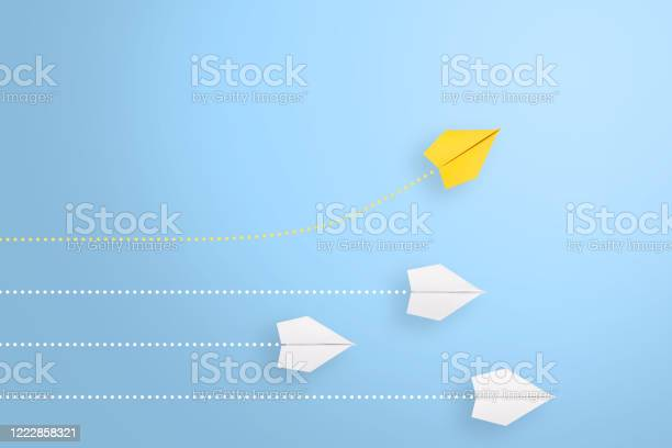 Photo of Change concepts with yellow paper airplane leading among white