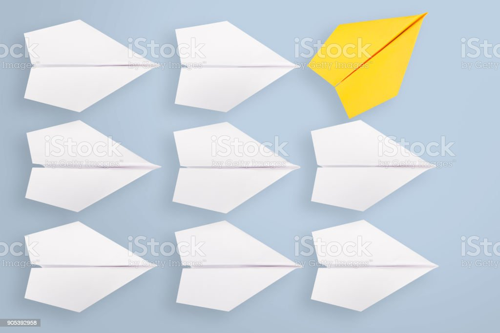 Change concepts with yellow paper airplane leading among white stock photo