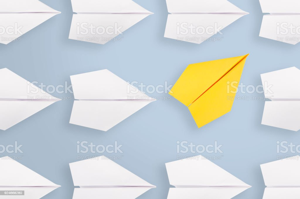 Change concepts with yellow paper airplane foto stock royalty-free