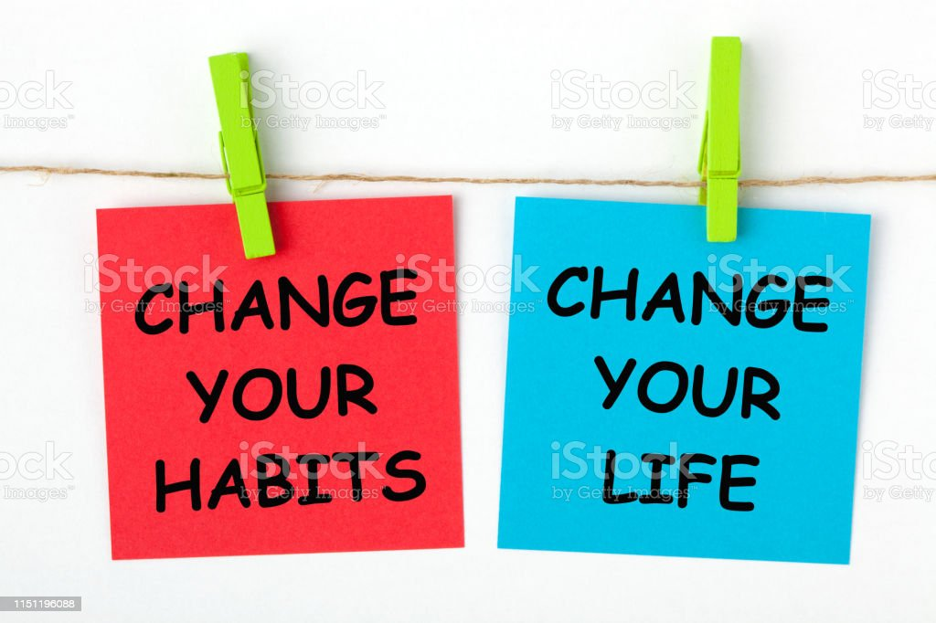 Change Your Life by Changing Your Habits text written on color notes...