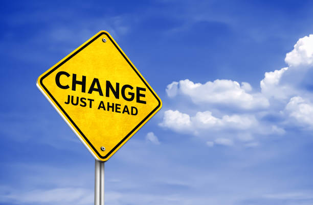 Change just ahead - roadsign information stock photo