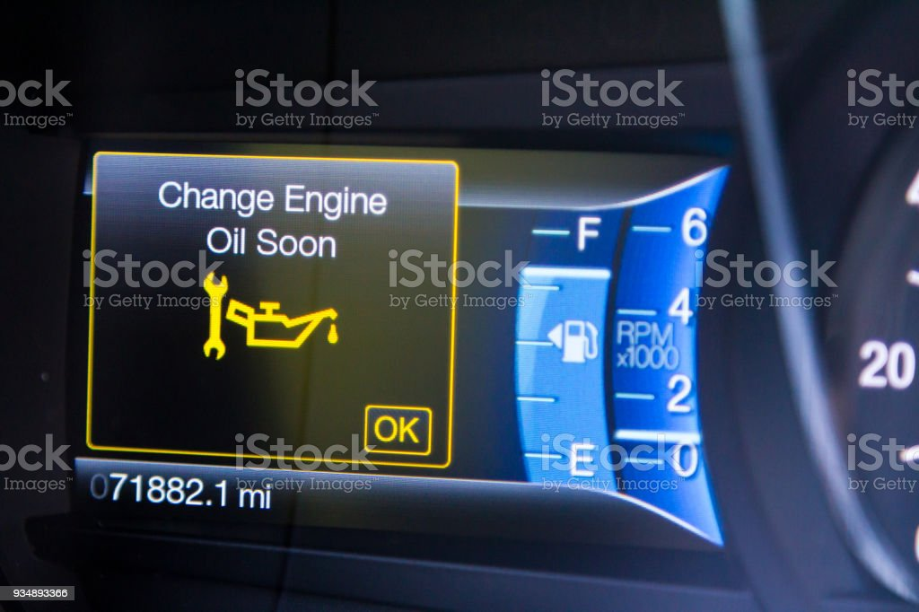 Change oil soon message on car dashboard stock photo