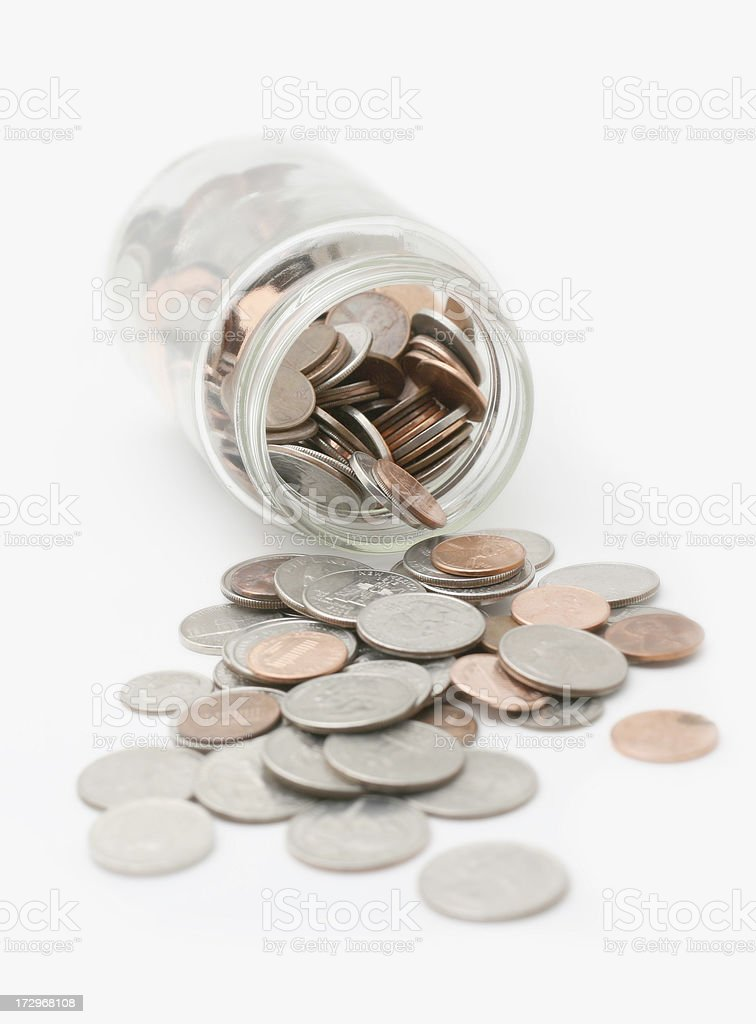 Change spilling from Jar royalty-free stock photo