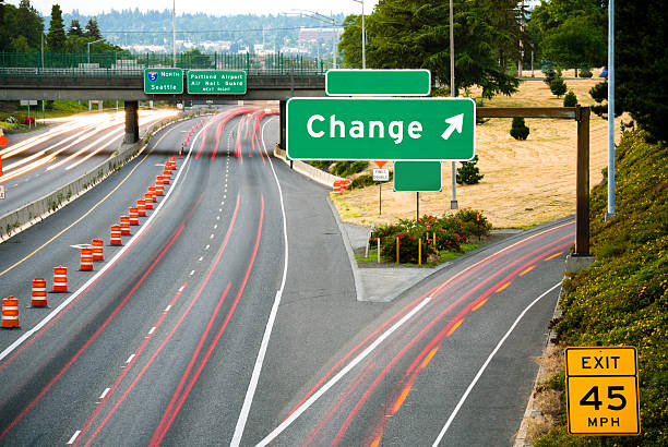 change: this way - exit sign stock photos and pictures