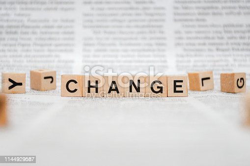 istock Change Word Written In Wooden Cube - Newspaper 1144929587