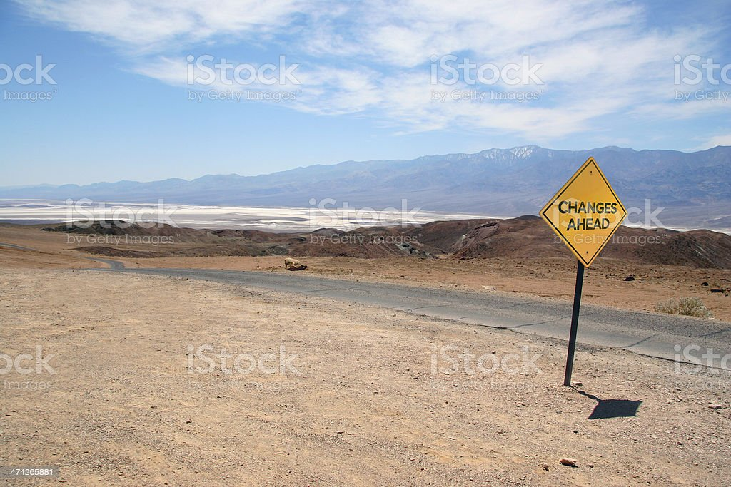 Changes Ahead - Road warning sign on empty desert route royalty-free stock photo