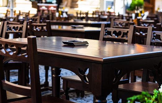 Changes and complications caused by coronavirus COVID-19 virus, world without crowds, empty tables, closed restaurants in old town, no travelers, no tourists