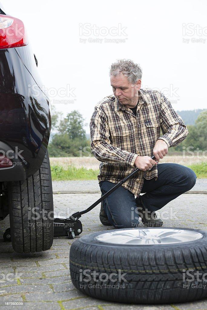 Changig Tires Reifenwechsel royalty-free stock photo
