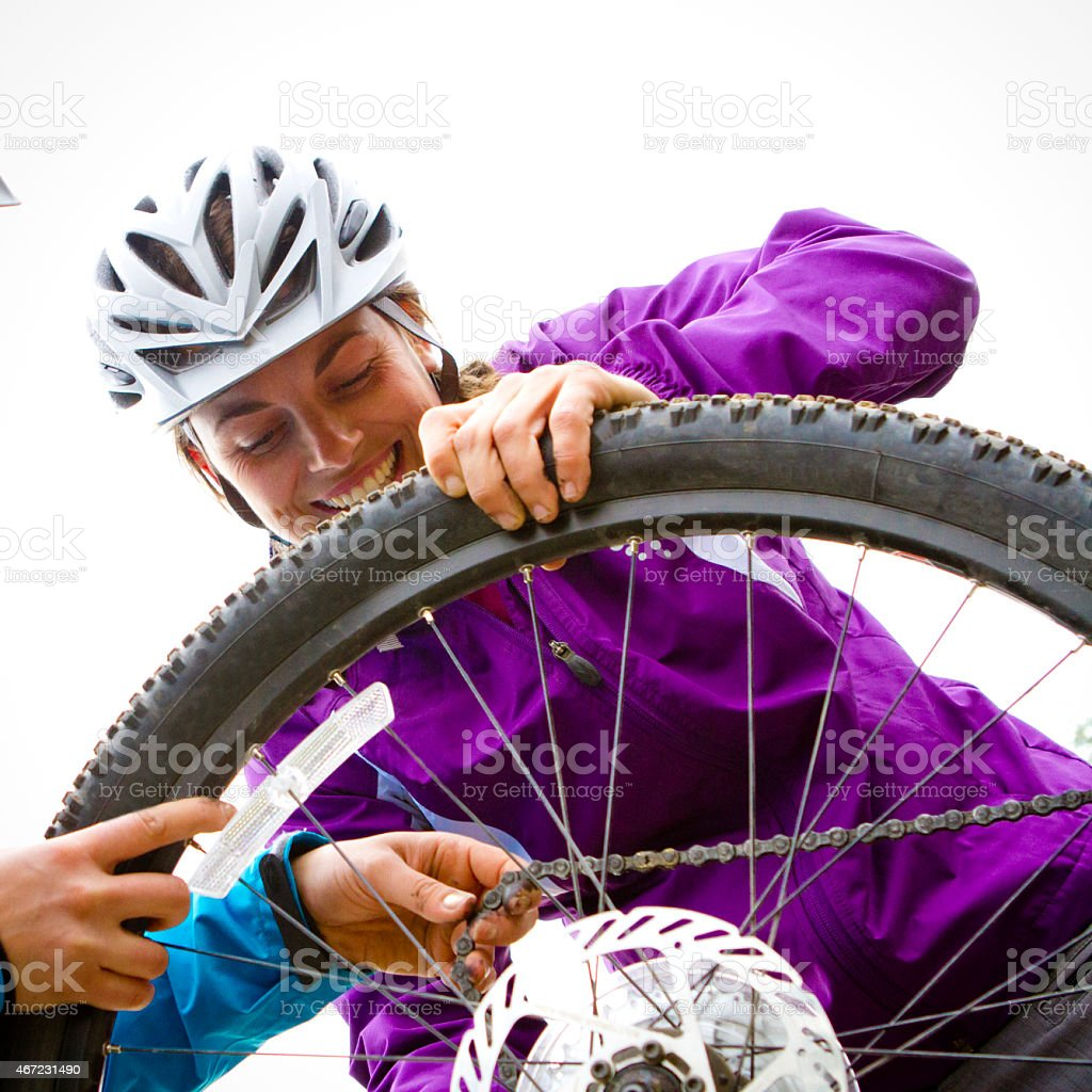 Changing a bike tire. stock photo