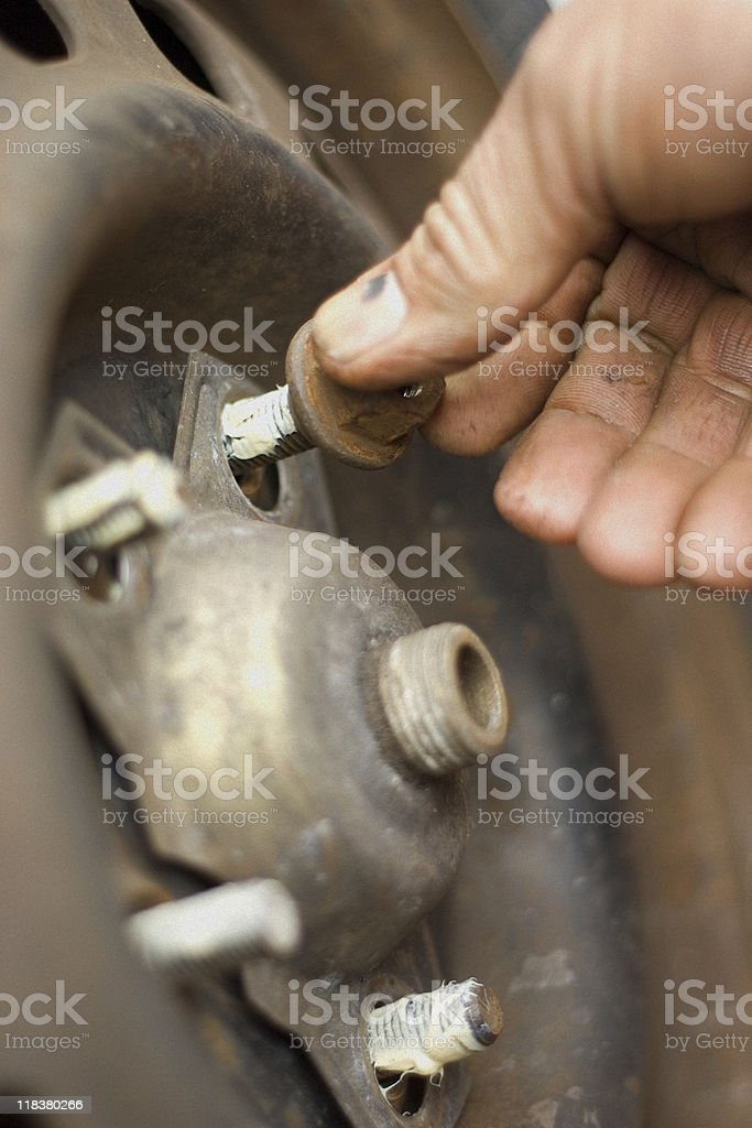 Changing a Tire - Lug Nut Closeup stock photo
