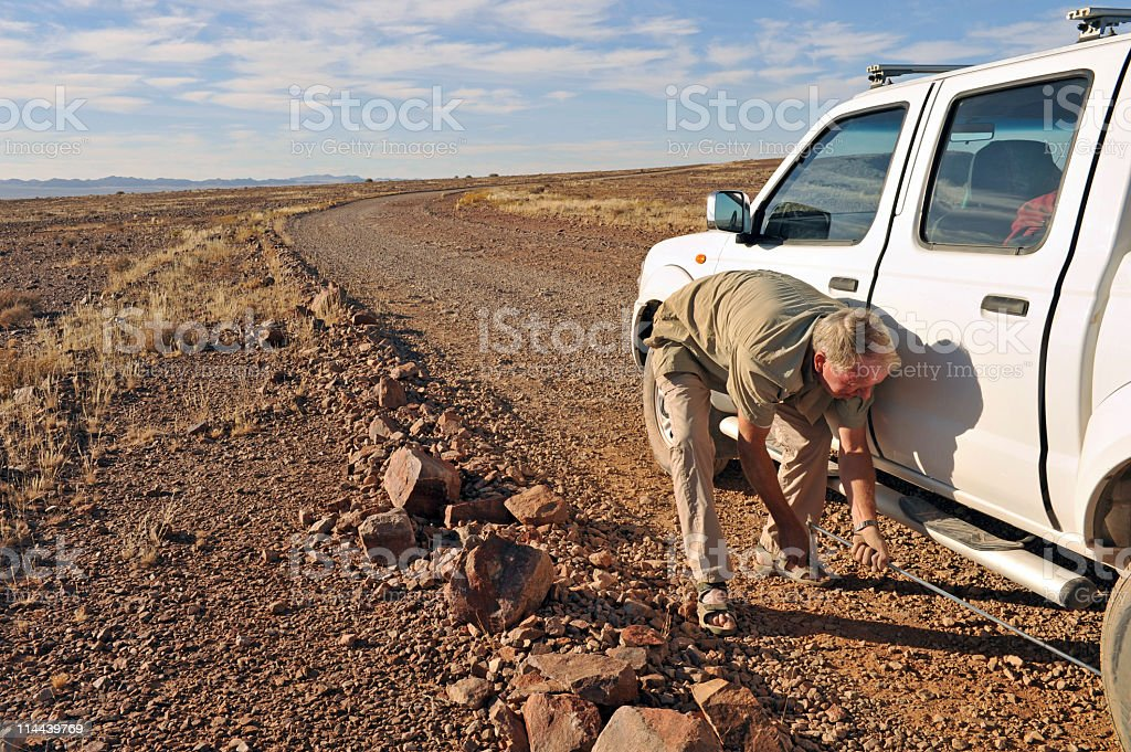 Changing a tire royalty-free stock photo