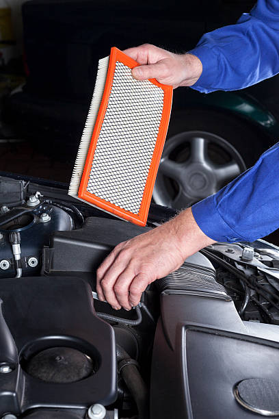 Changing an engine air cleaner/filter stock photo