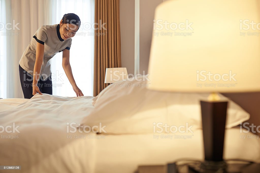 Changing bedclothes stock photo