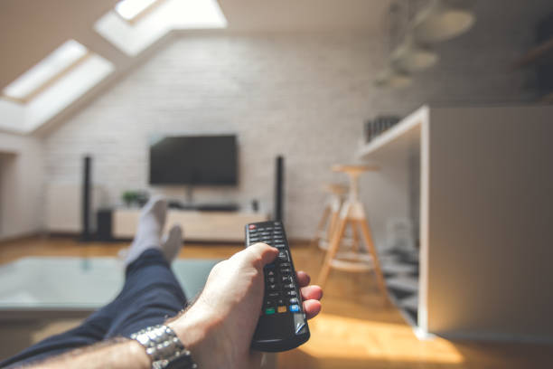 Changing channels on TV stock photo