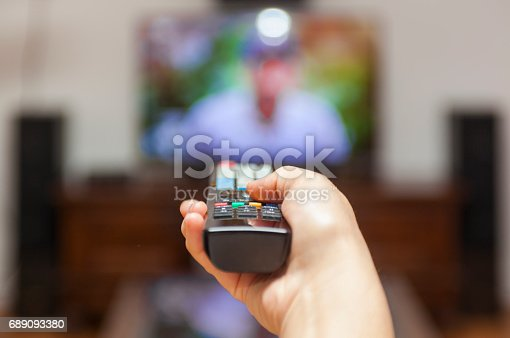 Using the remote control to change channels on Tv