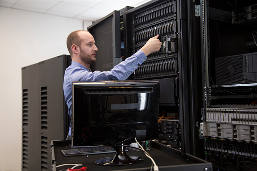 Changing Drive In Server Installation In Large Datacenter Stock Photo - Download Image Now