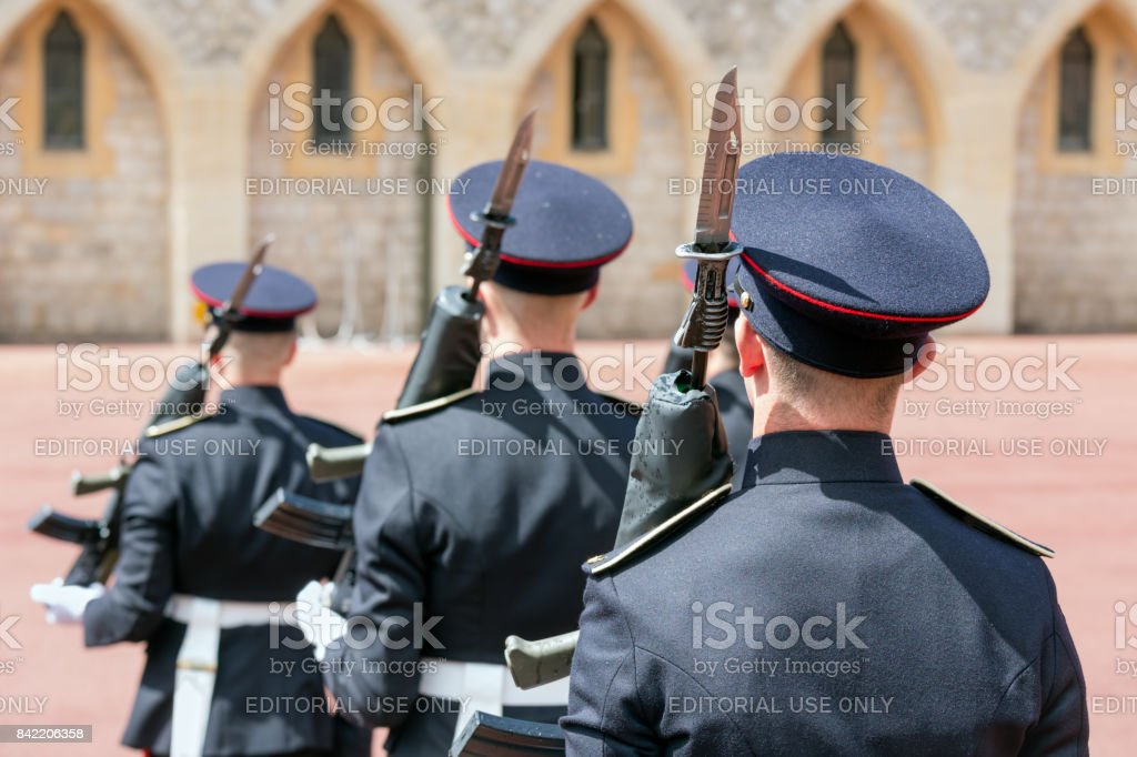 Changing guards with soldiers armed with rifles in Windsor Castle stock photo