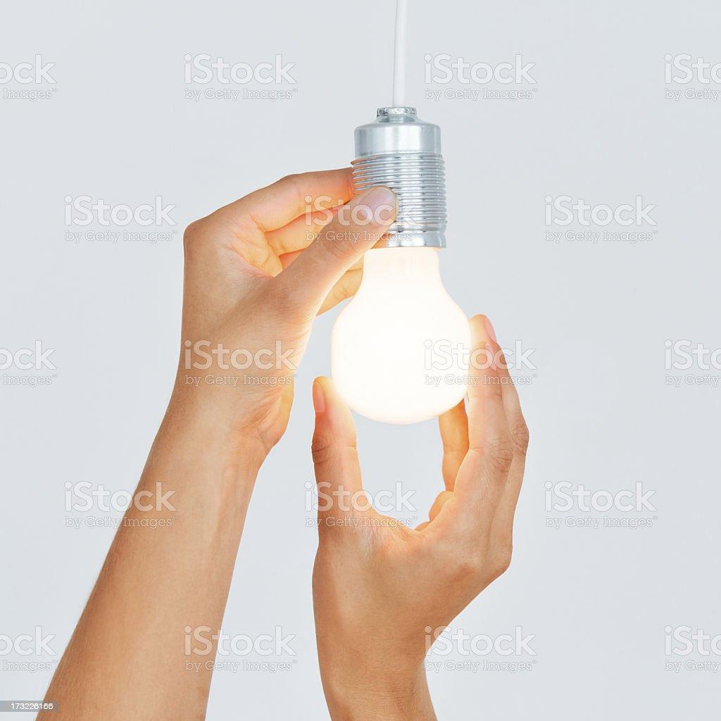 Changing Light Bulb stock photo