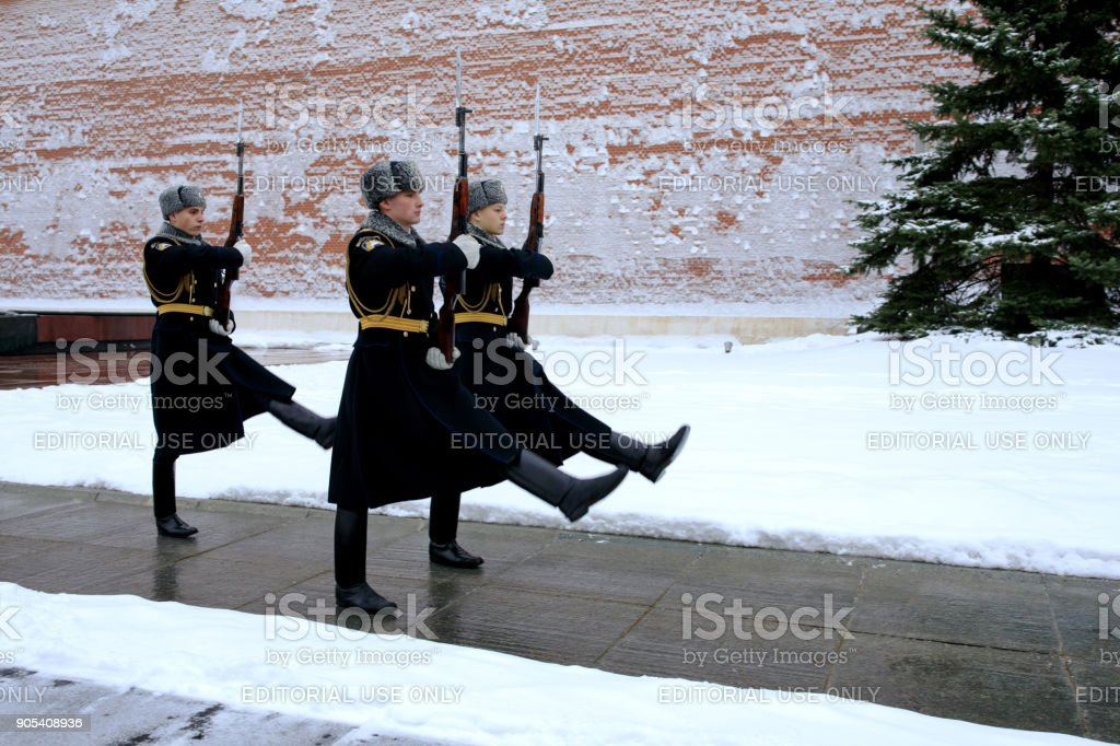 Changing of the Presidential guard of Russia at the Tomb of Unknown soldier and Eternal flame in Alexander garden near Kremlin wall. stock photo