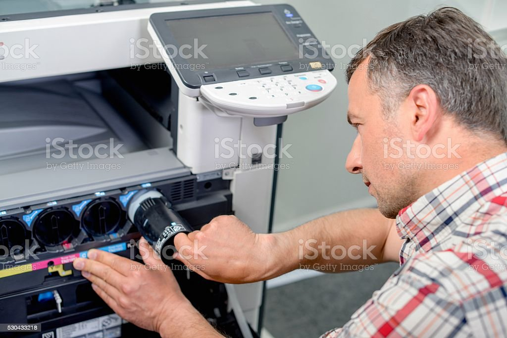 Changing printer ink stock photo