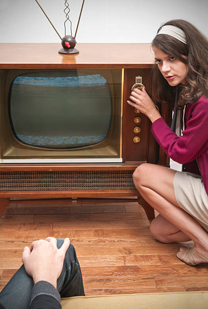 Changing stations on Old Television stock photo