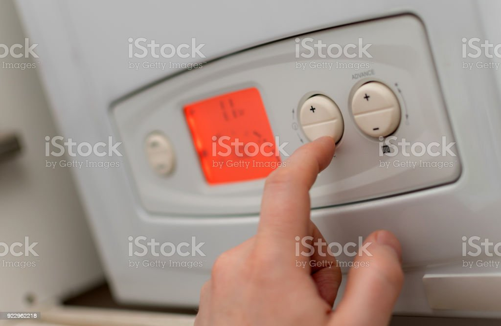 Changing temperature on a gas boiler stock photo