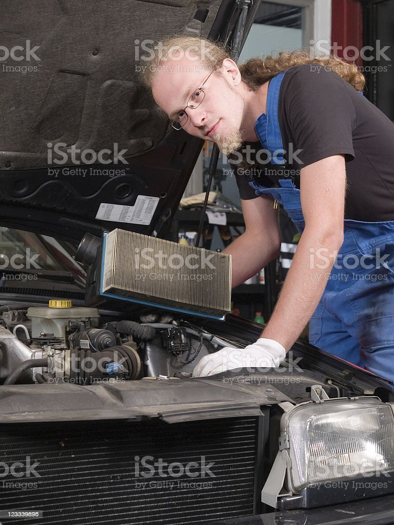 Changing the air filter royalty-free stock photo