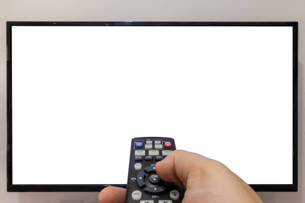 Changing the channels on a TV concept stock photo