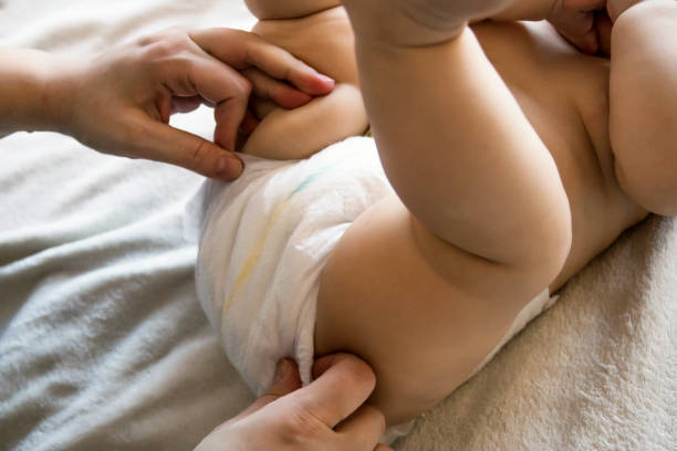 Changing the diaper stock photo