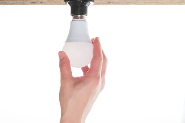 changing the lamp. Close-up of Hand changing the lamp. canadian football league stock pictures, royalty-free photos & images